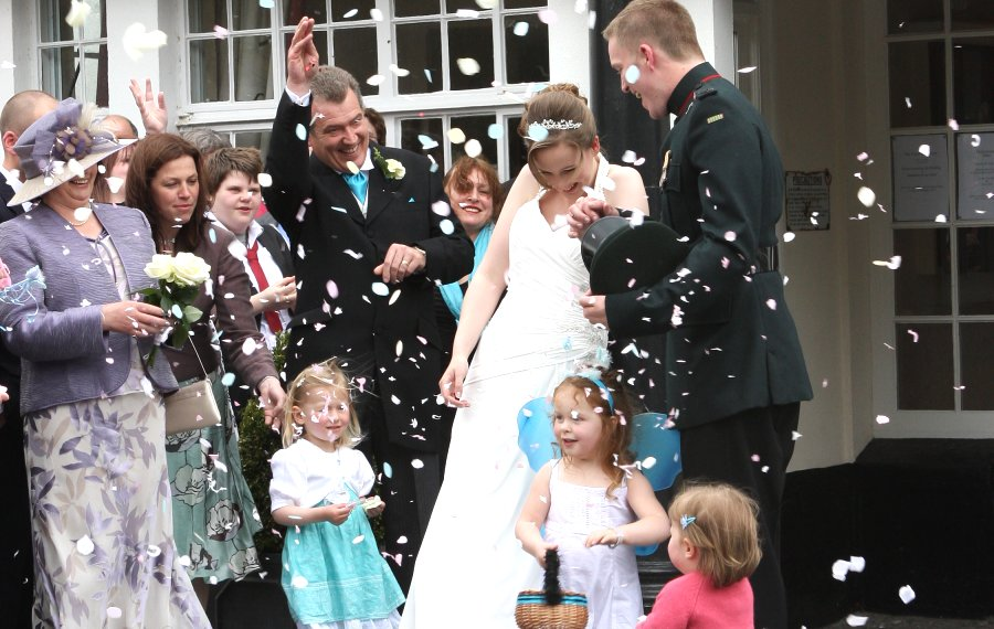 Confetti from everyone. Bertie and Dave, newlyweds at the Two Bridges Hotel.