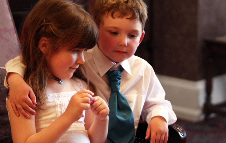 Young bridesmaid Ellen with her new pageboy pal at a niece's wedding.