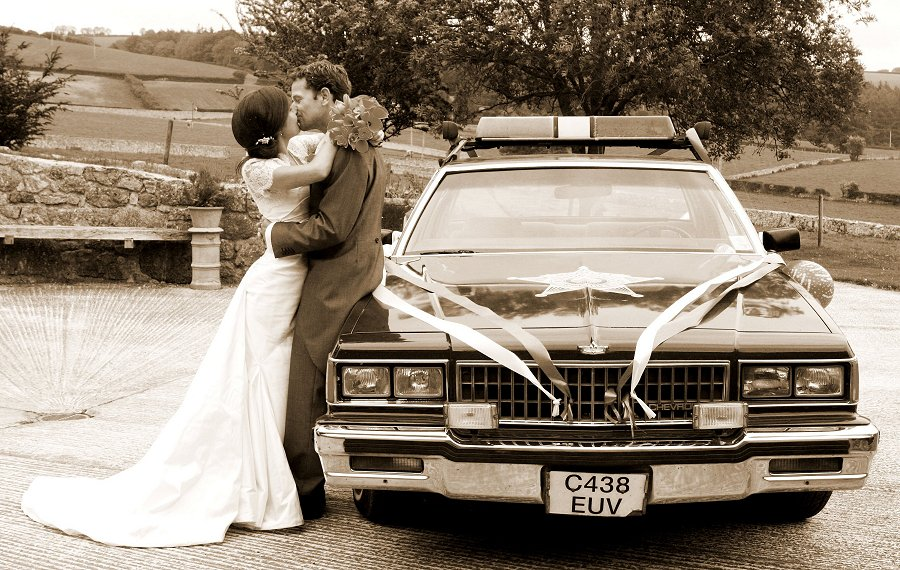 A day to remember. Catherine and Will with Will's American Police car.