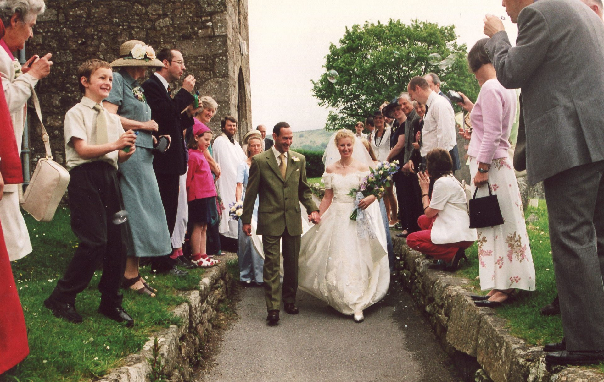 A Moretonhampstead wedding for Philippa and Graham. With the longest wedding veil ever.