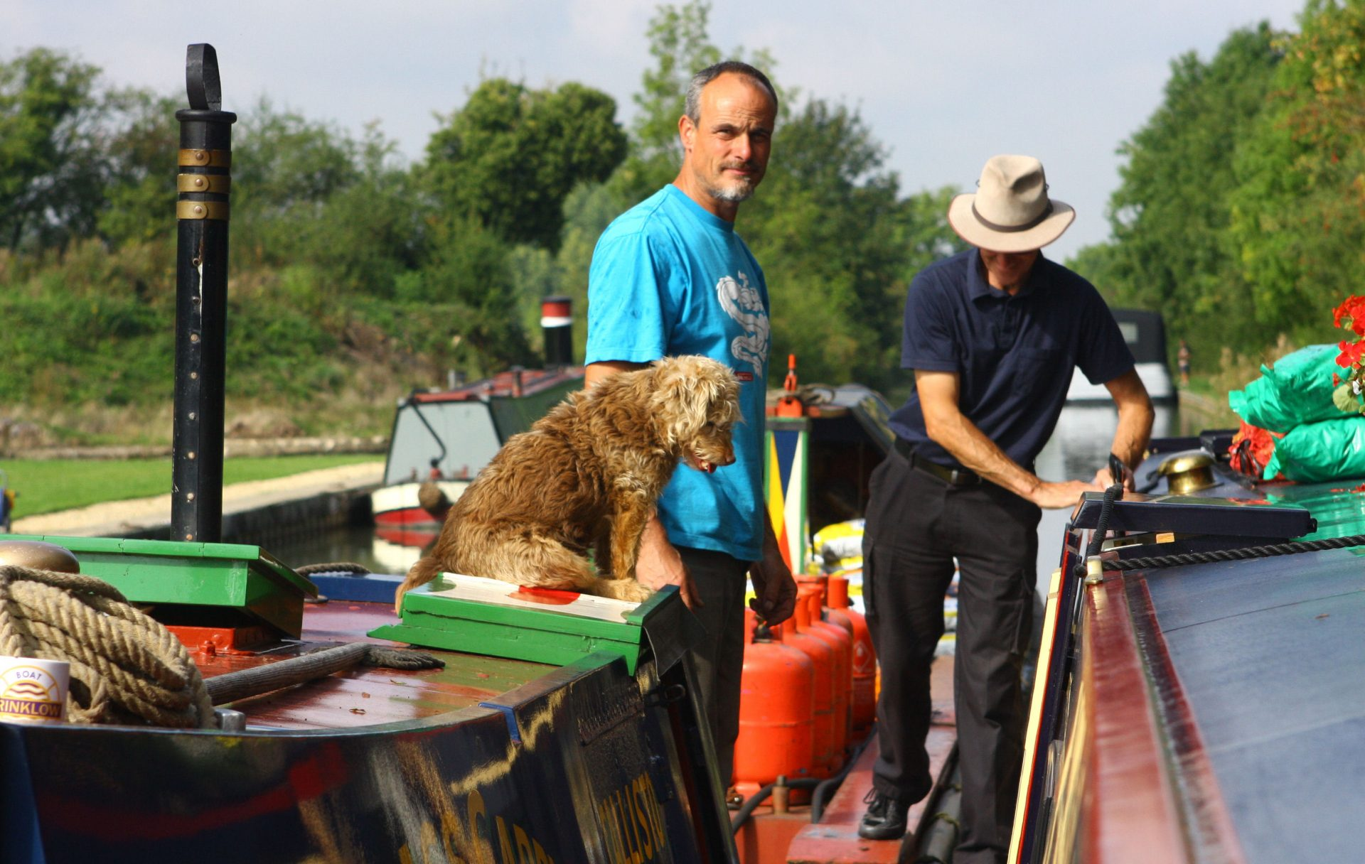 What dog wouldn't want a happy life on a  Waterways Fuel Boat ?
