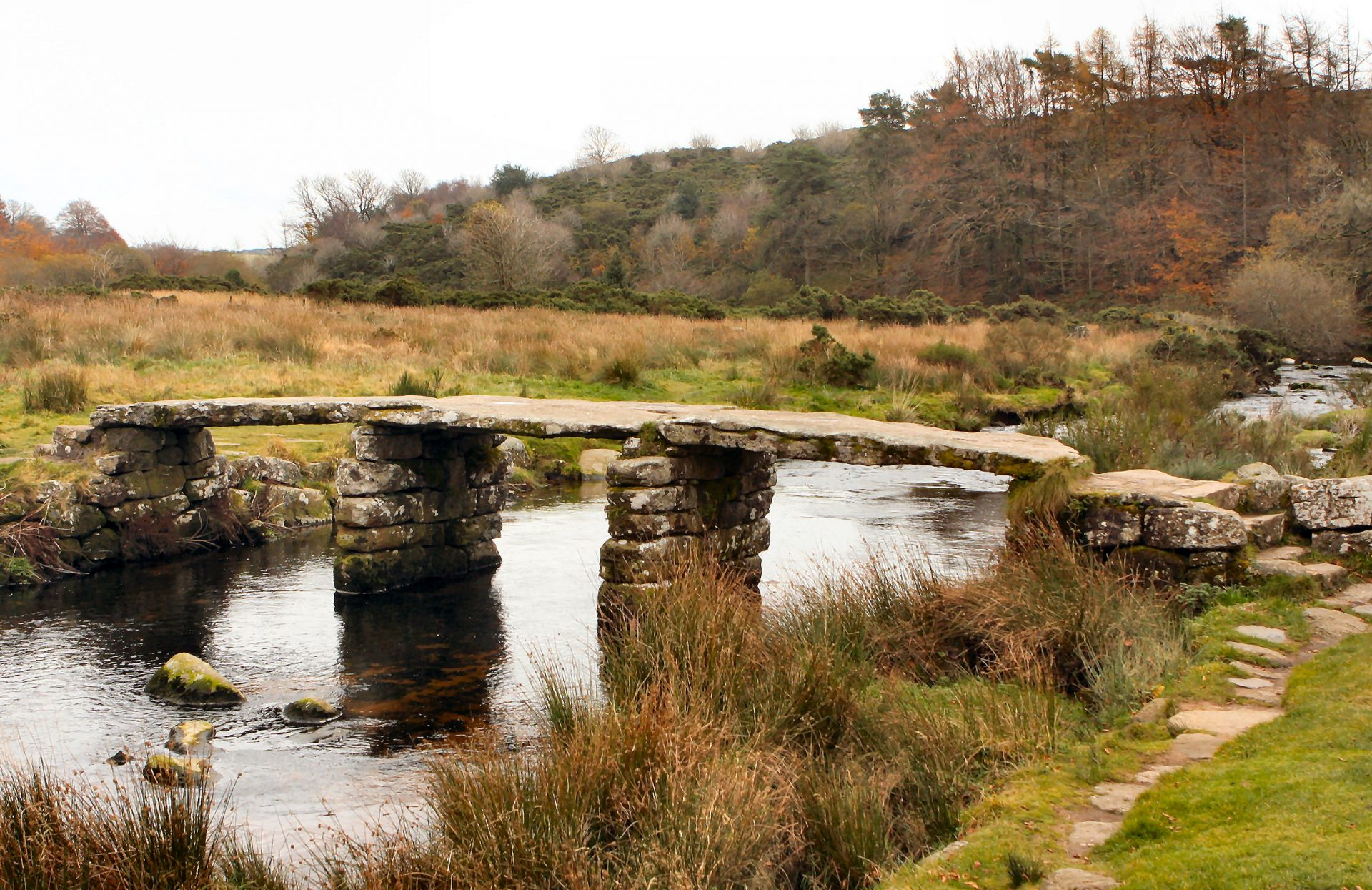 Postbridge. The ancient clapper bridge built of granite. Rarely without a tourist on top in Summer.