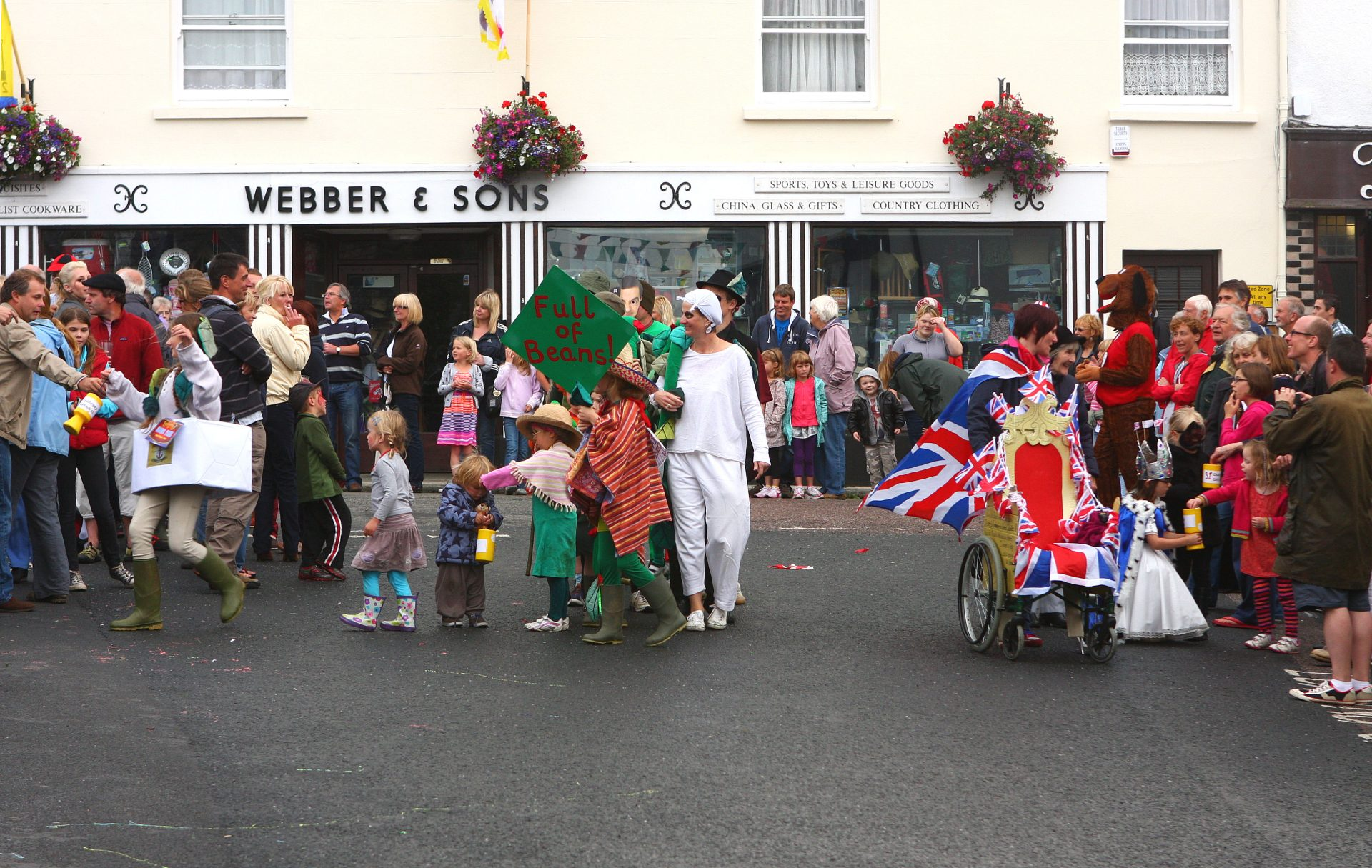 Chagford loves a colourful turnout. Bob Young in right hand crowd.