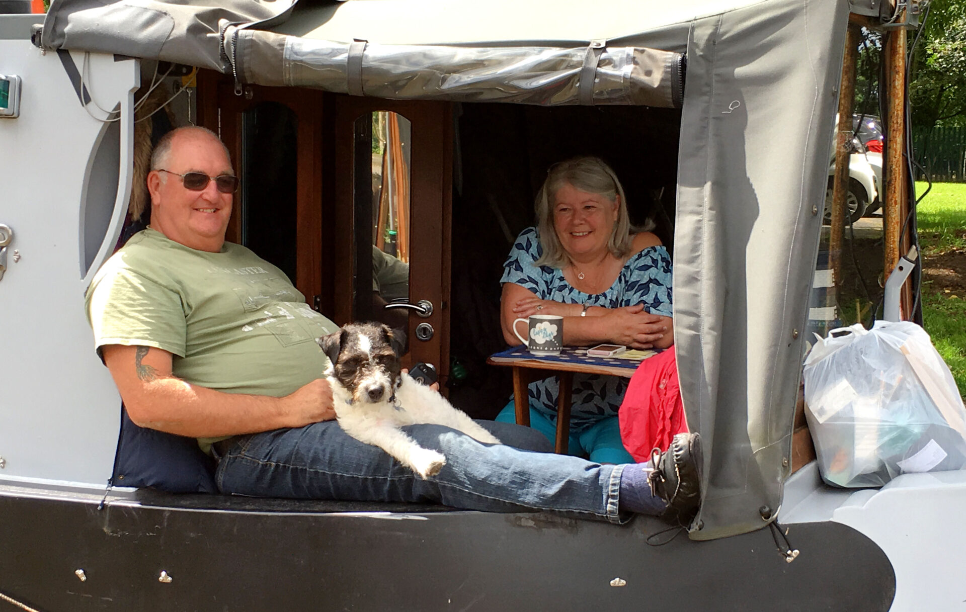 Steve, wife Chris and Smudge the dog chilling near to Chester. Well and truly happy on board.