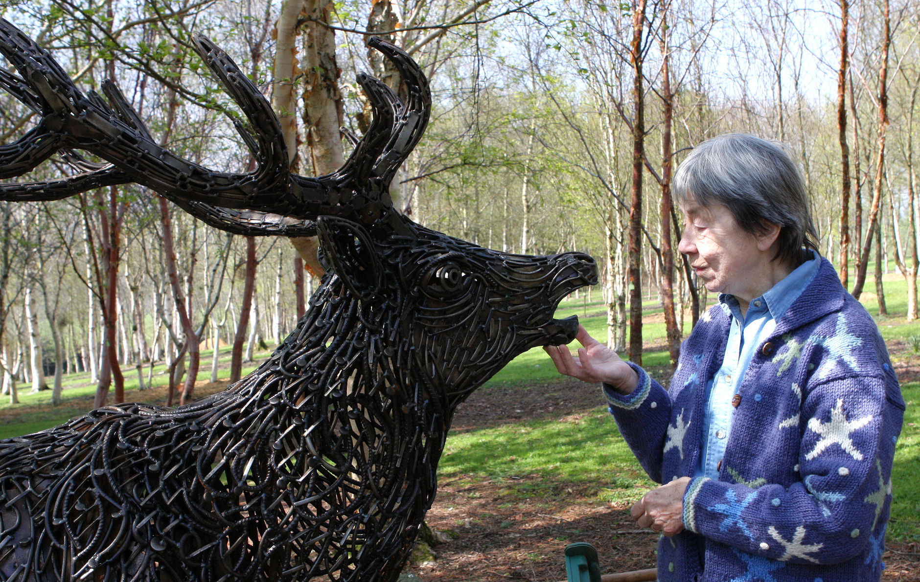 June with one of the sculptures at the Mythic Garden, near Chagford.