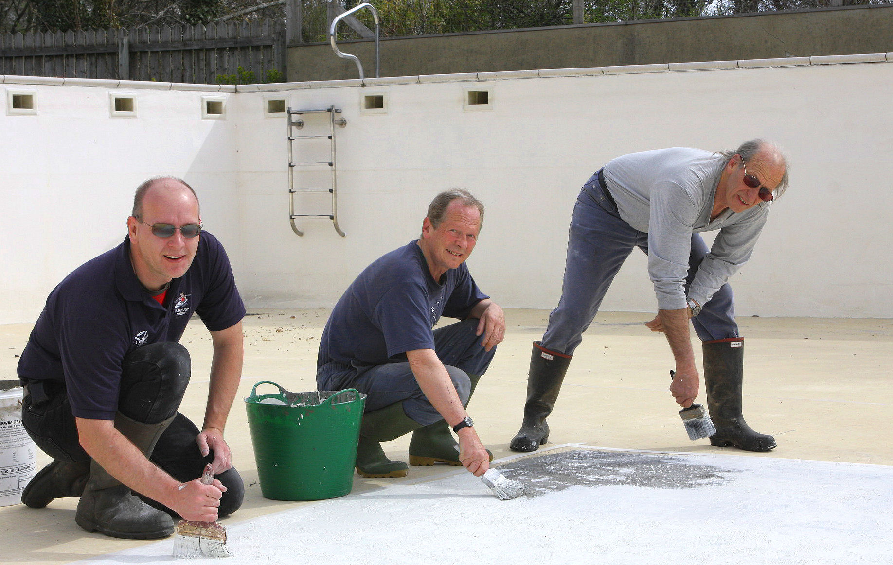 Painting the swimming pool 2008. Backbreaking work in the sun.