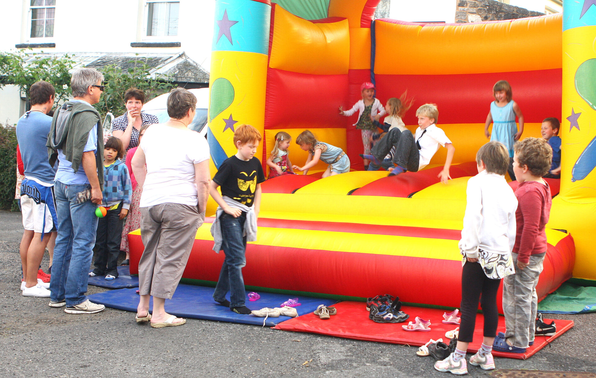 Queuing for the bouncy castle. Was it still inflated later on in the evening ? Who can remember ?