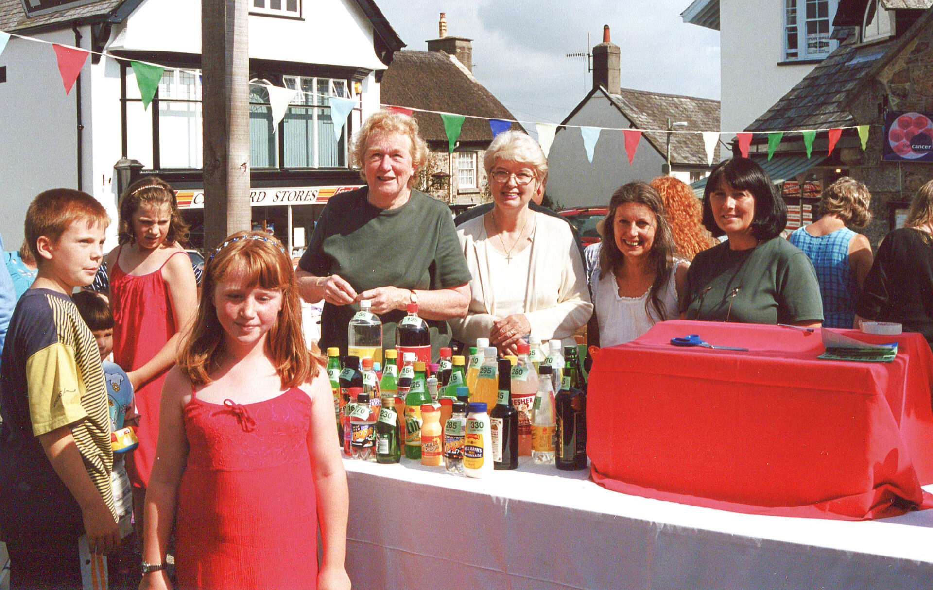 August Fair in the Square 2000. Pam, this lady ?, Mai and Ann on the tombola stall. Is the boy on the left called Paul ?