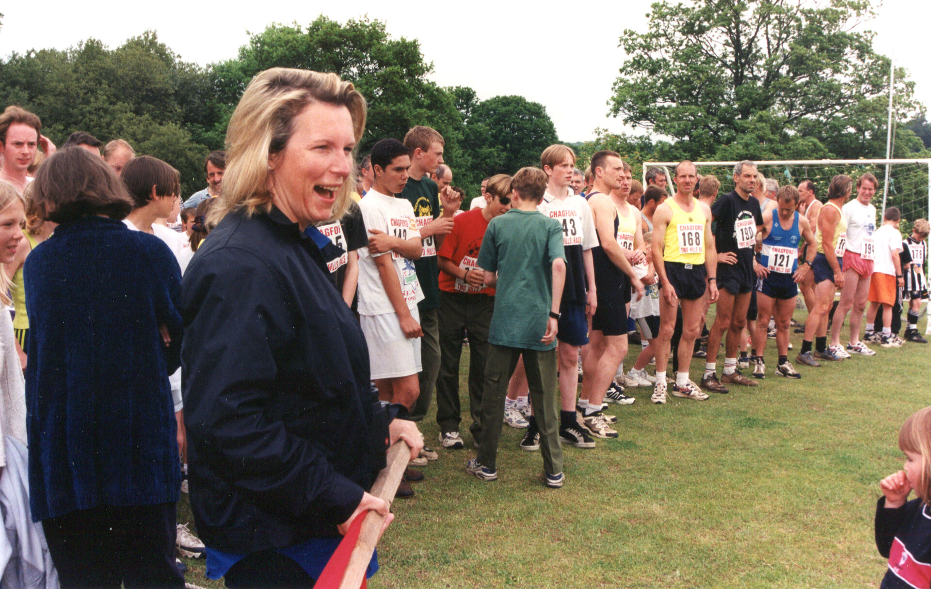 MOUSE OVER PICS TO HALT THE SLIDES. 1998 Jennifer Saunders with flag ready to start the race.