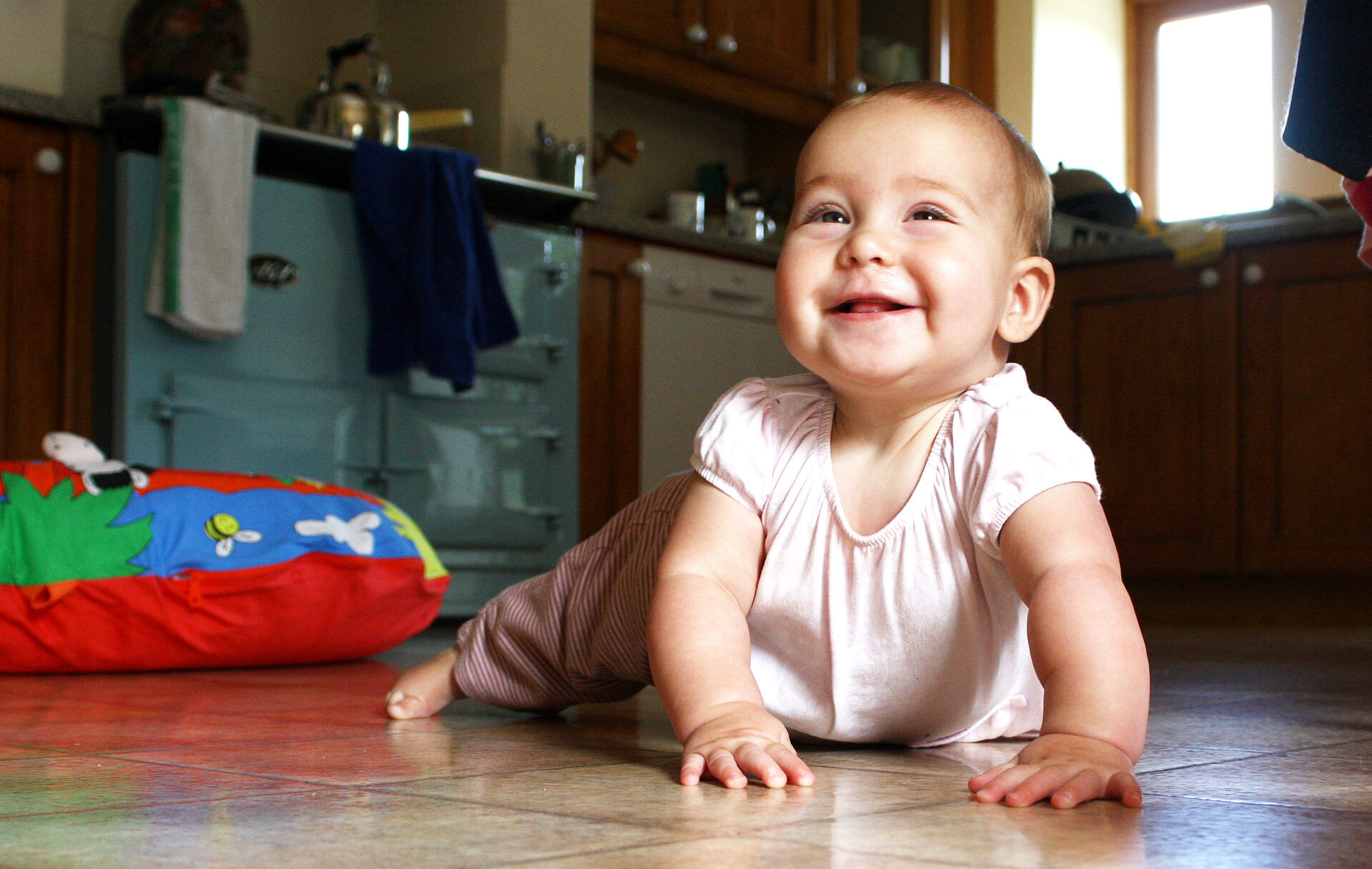 Elsie, our second granddaughter,  crawling at last..