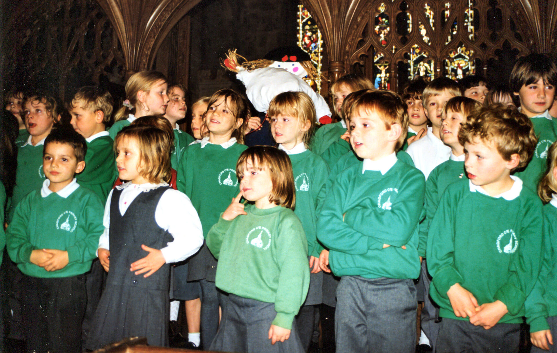 Chagford Church Service for the Primary School, for Harvest Festival, judging by the scarecrow in the background.
