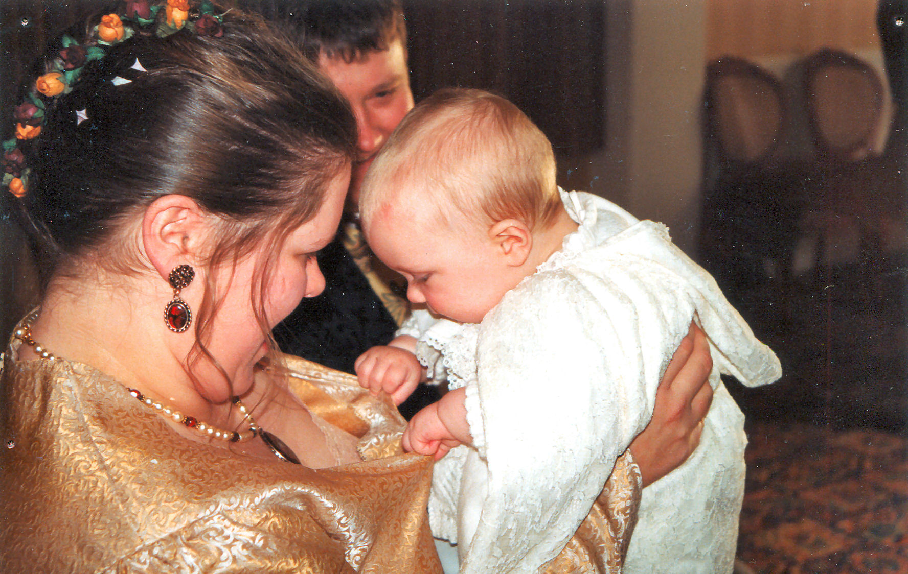 A joint wedding and christening in 1999, when young Jacob decided to check out Lisa's underpinnings !